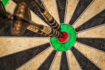 Three darts in bull's eye close up