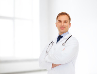 smiling male doctor in white coat with stethoscope