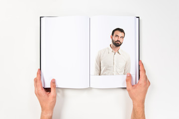 Young man thinking printed on book