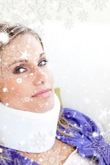 Young woman with a neck brace looking in the camera