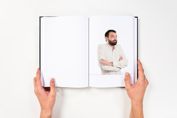 Young man satisfied printed on book