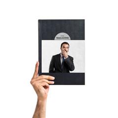 Businessman surprised printed on book