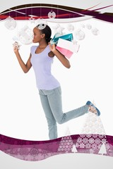 Woman with credit card and shopping on white background