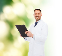 smiling male doctor with clipboard