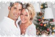 Composite image of couple embracing at christmas