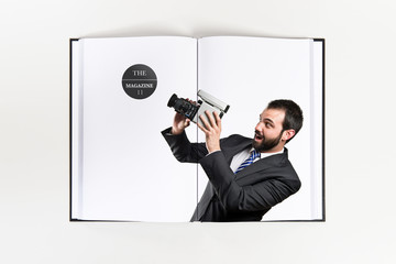 Young businessman recording video printed on book