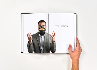young businessman with gas mask printed on book