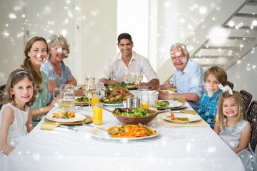 Composite image of family having meal together at dining table