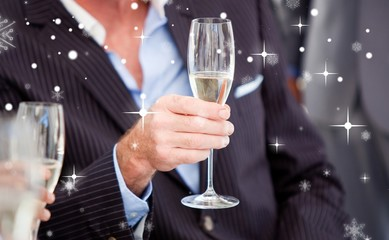 Close up of a senior businessman holding a glass of champagne