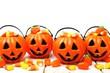 Row of Halloween Jack o Lantern candy holders on wood