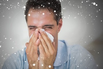 Composite image of closeup of a man suffering from cold