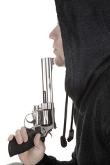 profile of man close with gun and hoodie