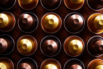 Gold and brown coffee capsules