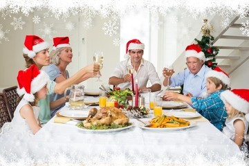 Family toasting wine while having christmas meal