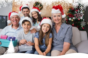 Extended family in christmas hats with gift boxes