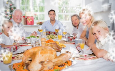Composite image of focus on the roast turkey in front of family