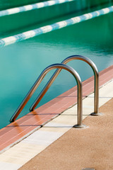 Steel ladder of swimming pool in Day