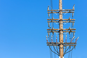 Electricity wood utility pole connections, blue sky, copy space