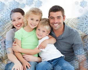 Adorable family sitting on the sofa and smiling