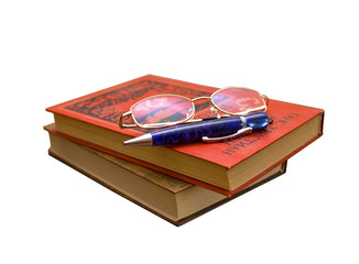 Books and glasses and pen isolated