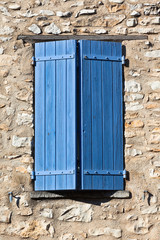 House facade with blue shutters in France
