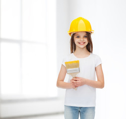 smiling little girl in helmet with paint roller