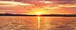 Leinwandbild Motiv amanecer radiante sobre el mar
