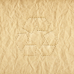 Old paper background with recycle symbol