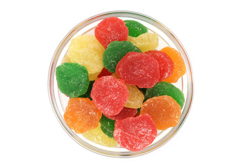 pieces of colored jelly on white background