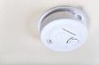 Leinwandbild Motiv Carbon monoxide alarm mounted on the ceiling