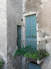 Old doorway, forgotten neglected garden. Italy.
