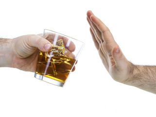 hand reject a glass of whisky