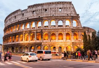 ROME - NOVEMBER 2, 2012: Tourists enjoy Colosseum at night. More