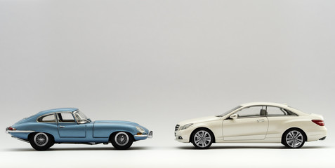 Blue and White Classic Retro and Modern Sports Cars
