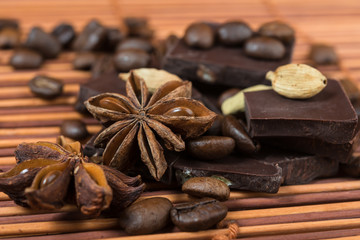 Close up of  anise, cardamom with chocolate and coffee heap
