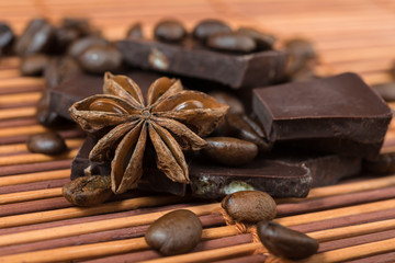 Close up of  anise with chocolate and coffee heap
