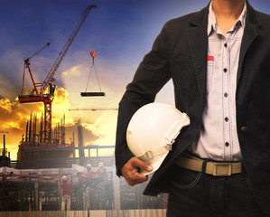 engineering man and white safety helmet working in construction