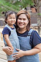 mother and children wearing jeans suit smiling face