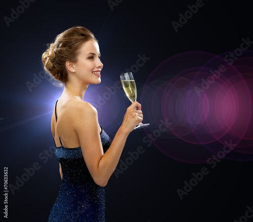 canvas print picture smiling woman holding glass of sparkling wine