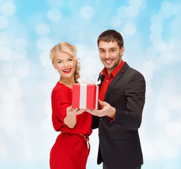 smiling man and woman with present