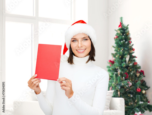 canvas print picture smiling woman in santa hat with greeting card