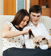 young couple with kitten