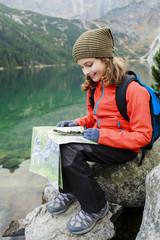Hiking, trekking - young girl on mountain trek