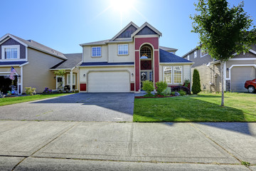 Beautiful house with high entrance porch in red trim