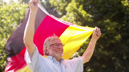 Old Man with German Flag held high