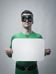 Superhero holding a blank sign