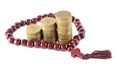 Idea of religion as business - rosary with coins