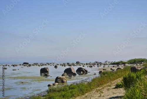 Leinwanddruck Bild Rocky beach in the hot summer morning