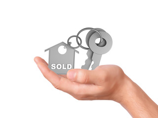 Holding house keys. sold concept