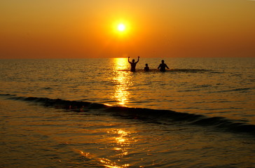 Sport and recreation at the sunrise on the romanian beach